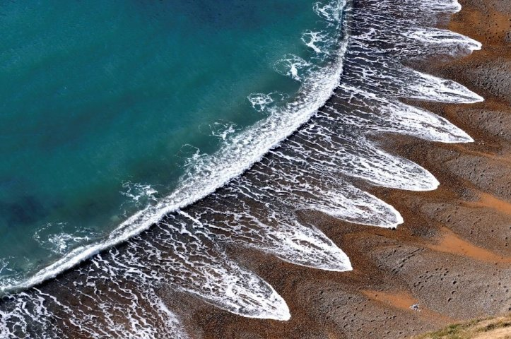 Feathered Waves_PoemTrail
